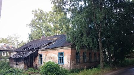 Abandoned brick and wooden houses in pishchita, located in Ostashkov, Tver region, Russia