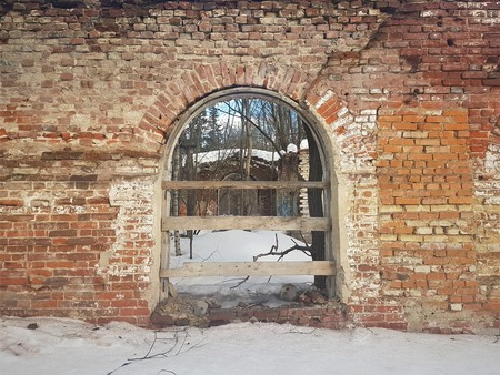 abandoned and destroyed red brick building in winter