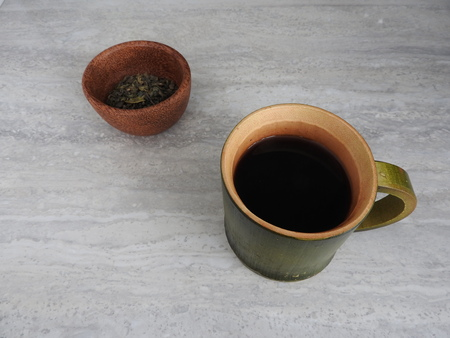 Green bamboo cylinder coffee cup, nature product from bamboo, with mountain view background