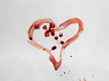 Heart drawn in blood on a white background, the theme of love Stok Fotoğraf
