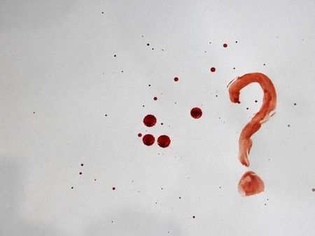 Spots and drops of fresh blood on a white background and a question mark Фото со стока