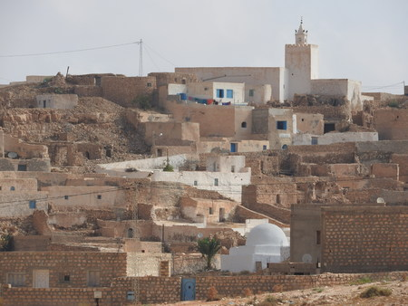 Berber village Tamezret Gabes province mosque hot desert of North Africa in Tunisia Stock Photo