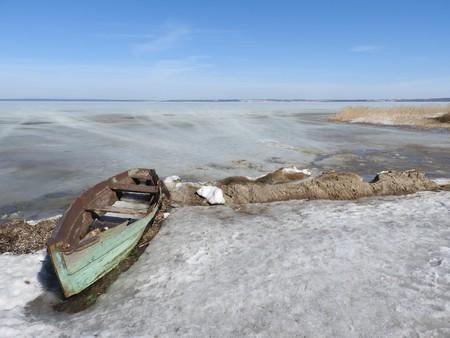 Boat in winter on the shores of lake Pleshcheyevo, Pereslavl Zalessky, Yaroslavl region, Russia on a clear day Stock Photo