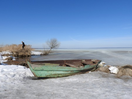Boat in winter on the shores of lake Pleshcheyevo, Pereslavl Zalessky, Yaroslavl region, Russia on a clear day