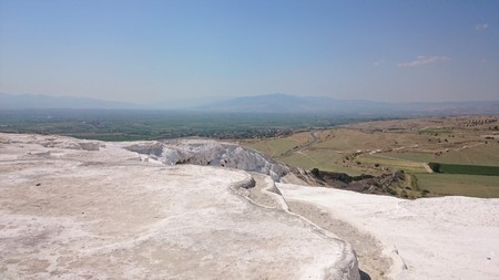 Charming Pamukkale pools in Turkey, they contain hot springs and travertines, terraces of carbonate minerals left behind by running water.