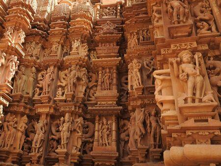 Erotic sculptures and poses of man in kajuraho temples, Madhya Pradesh, India.