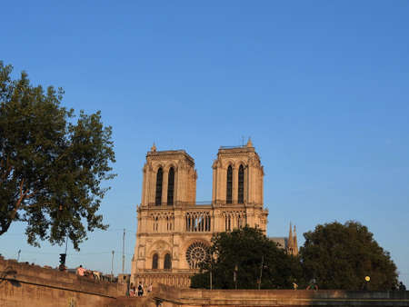 Notre Dame, the most beautiful Cathedral in Paris, UNESCO heritage. View from the river Seine to tragedy and fire, France