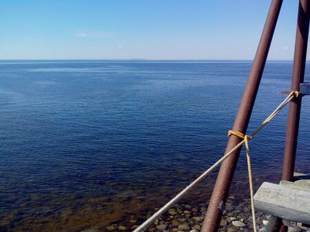 The coastal zone of the White sea at Cape Beluga, watching tower blagami, Solovetsky Islands, Arkhangelsk oblast, Russia. Фото со стока