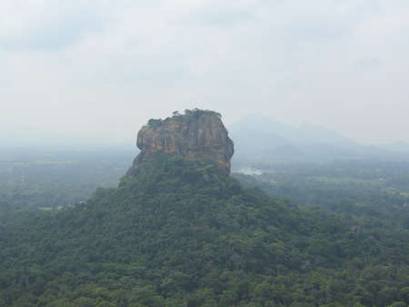 The historical Sigiriya rock fortress is surrounded by a breathtaking landscape. 免版税图像