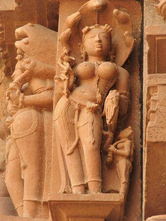 Erotic sculptures and poses of man in kajuraho temples, Madhya Pradesh, India. Built around 1050