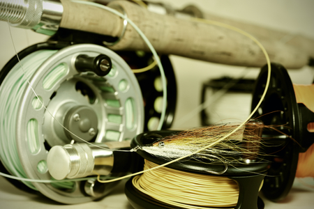 distraction: Fly rods and reels.Fishing tackle. Stock Photo