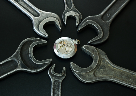 rackwheel: The clock mechanism is surrounded of spanners,