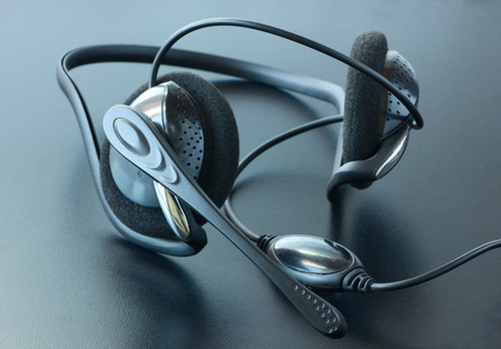 joining services: Headphones with a microphone.Headset.Tinted image. Stock Photo