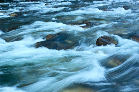 limpid: Fast for rapid mountain river.Tinted image.