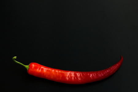 incarnadine: The pod of red pepper on a black background. Stock Photo