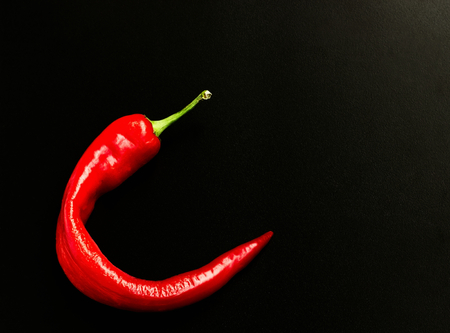 vermeil: The pod of red pepper on a black background. Stock Photo
