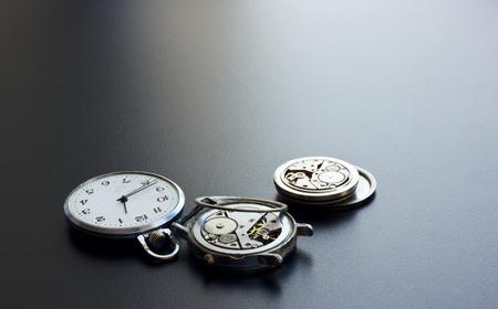 unfit: The old broken clock on a black background.