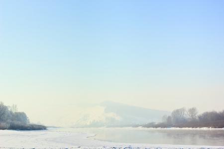 lucid: Winter landscape with river