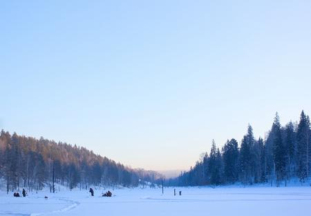 icily: Winter.Fishermen on the frozen pond.