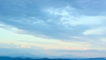 Sky over mountainous country. Stock Photo