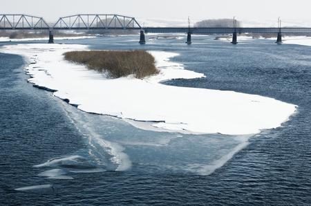 inhospitable: Winter river and railroad bridge.Tinted image. Stock Photo