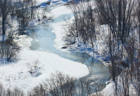 Winter landscape with a small river.View from above.