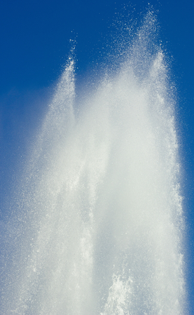 insipid: Fountain.The stream of water against the blue sky.