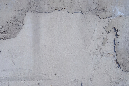 scabrous: A fragment of a roughly plastered wall. Stock Photo