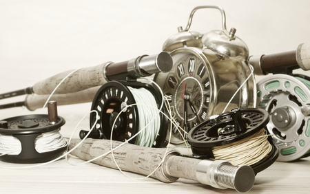 Fly fishing rods and alarm clock. Its time to go fishing.