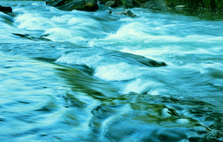 Stormy river stream.Tinted image. Stock Photo