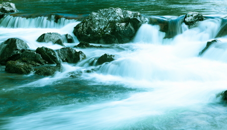 Waterfall on a mountain river.Tinted image. Reklamní fotografie