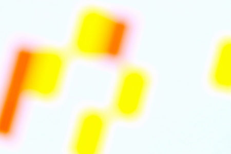Bright colored spots on a white background.Blurred image