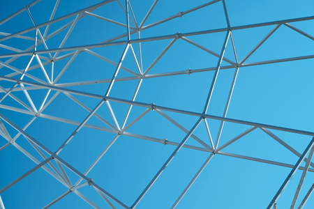 Metal constructions on the blue sky background. Stock Photo