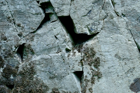 Deep crack in the rock wall.