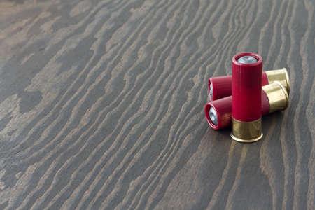 Three 12 guage shotgun shells