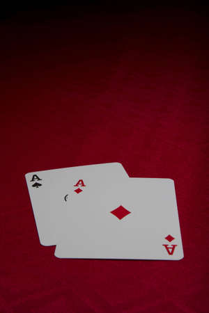 Two ace cards on red background