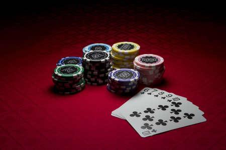 straight flush: Poker chips and a straight flush