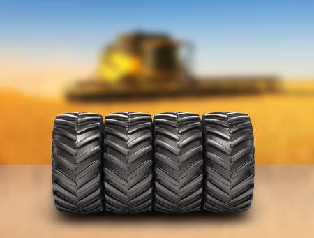 Off-road wheels on agricultural background 3D Stock Photo