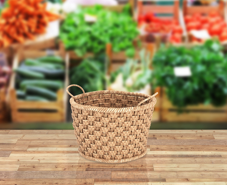 Empty wicker basket on wood floor and market background with reflection 3d