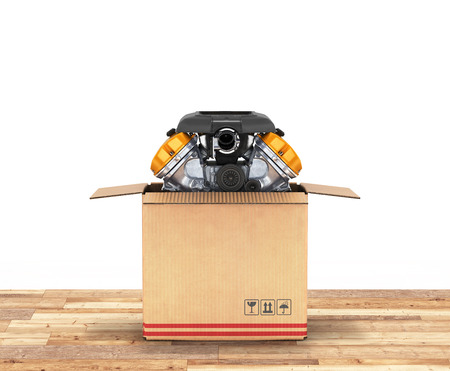 Engine in a cardboard box Concept of sale and delivery of auto parts on wood floor and white background 3d Stock Photo