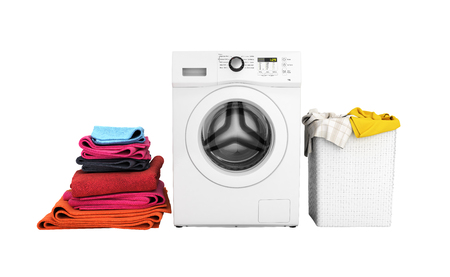 Concept of washing clothes Washing machine with colored towels and washing basket with dirty clothes isolated on white background 3d render without shadow Stockfoto