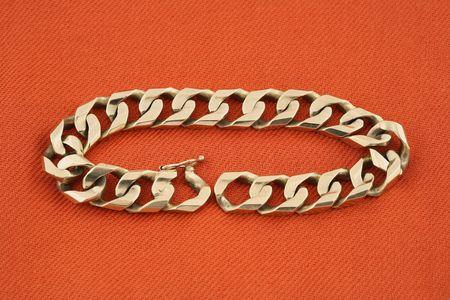 jewelery 017 gold bracelet red background. Stock Photo
