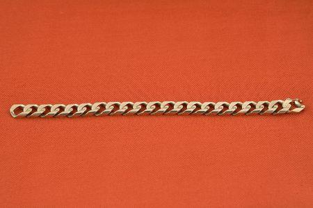 jewelery 018 gold bracelet red background. Stock Photo
