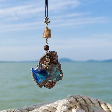 Hand made necklace on the Balaton lake background Stock Photo