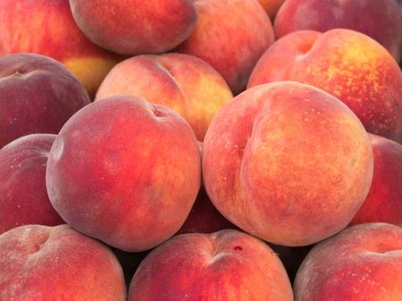 Fresh organic peaches at a farmers market Stock Photo