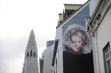 building wall: Lady hide around Hallgrimskirkja Editorial