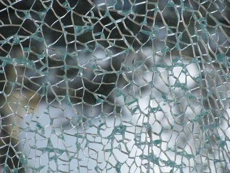 cracked glass: Glass cracked in spider web pattern Stock Photo