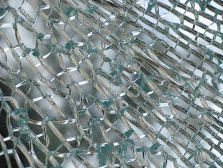 Glass cracked in pattern of silver streaks