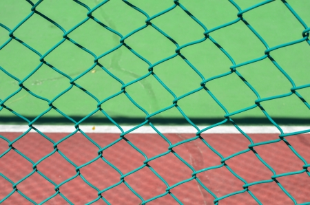 barb wire on tennis court background photo