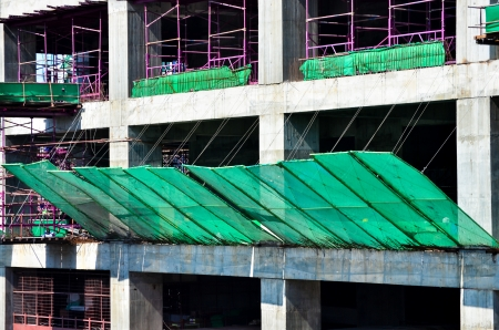 safety net: green mesh for safety at construction site